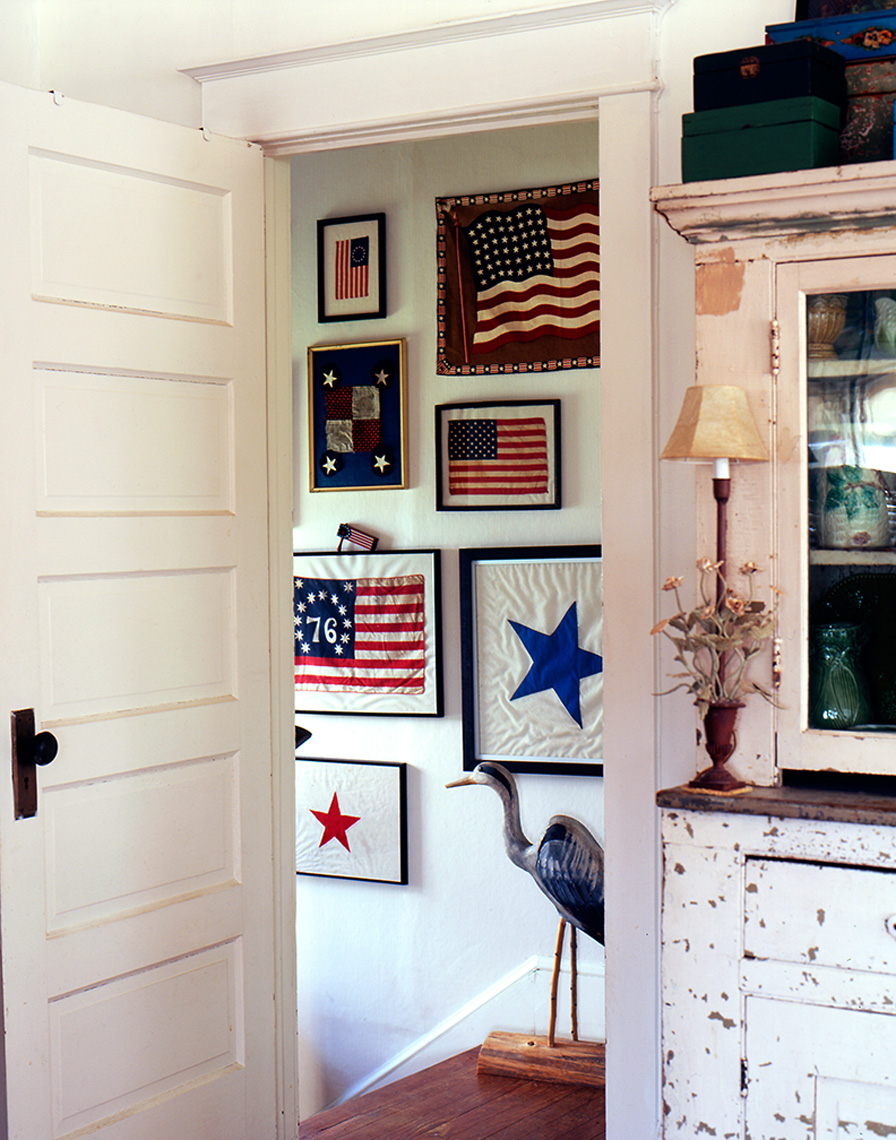saris with flags on wall