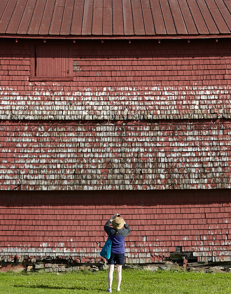woman photographing distressed red bad belfast maine