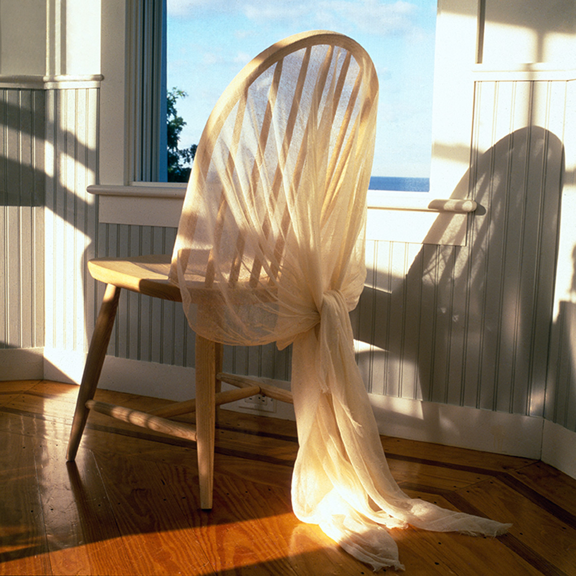 chair with gauze fabric in sunlight