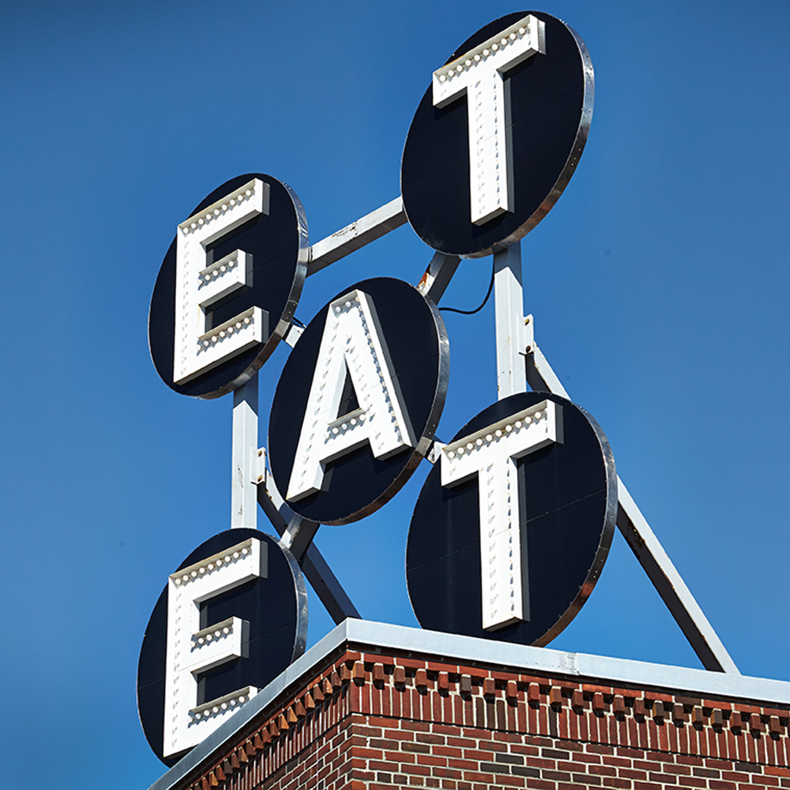 eat sign blue sky