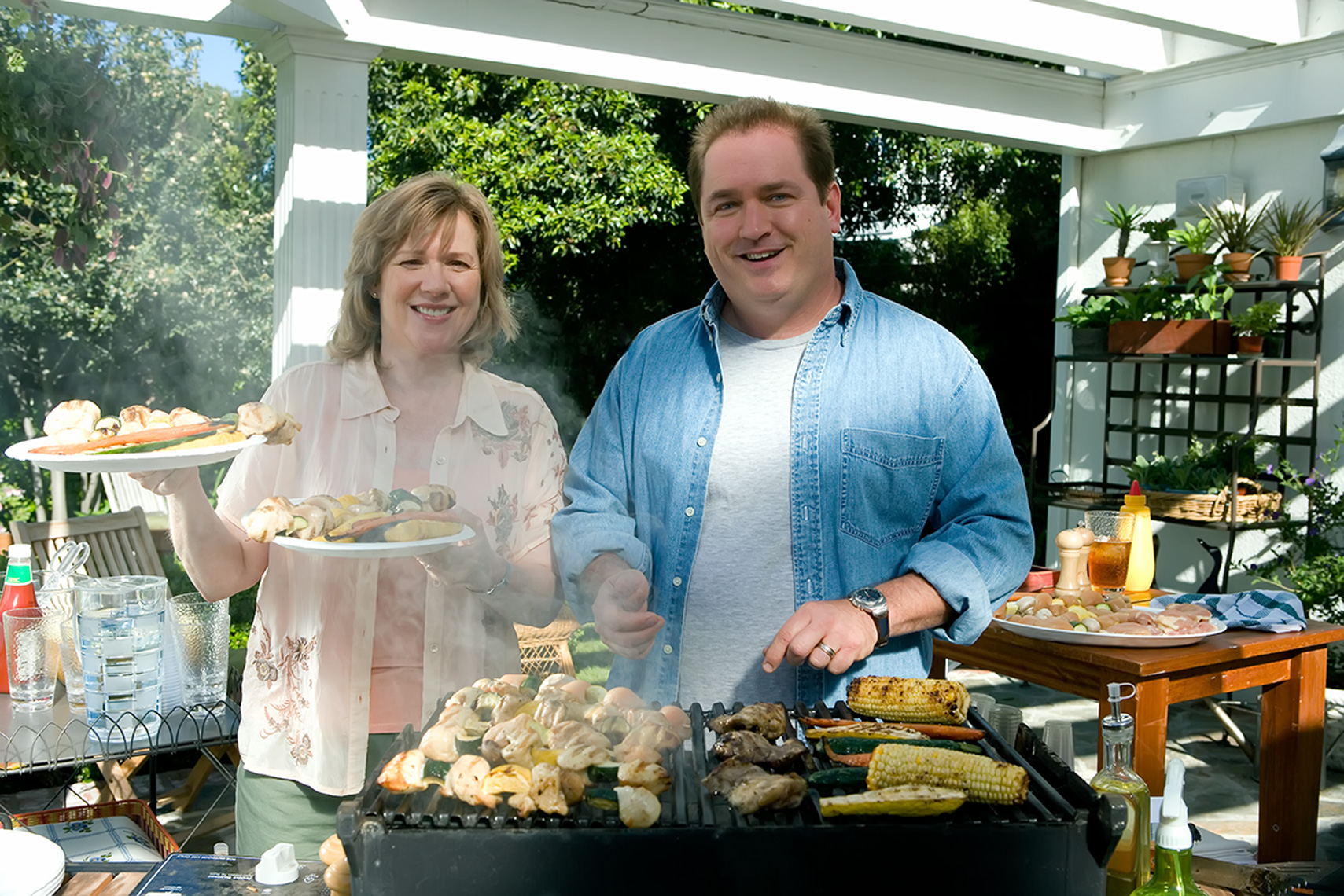 couple with gilled food on patio