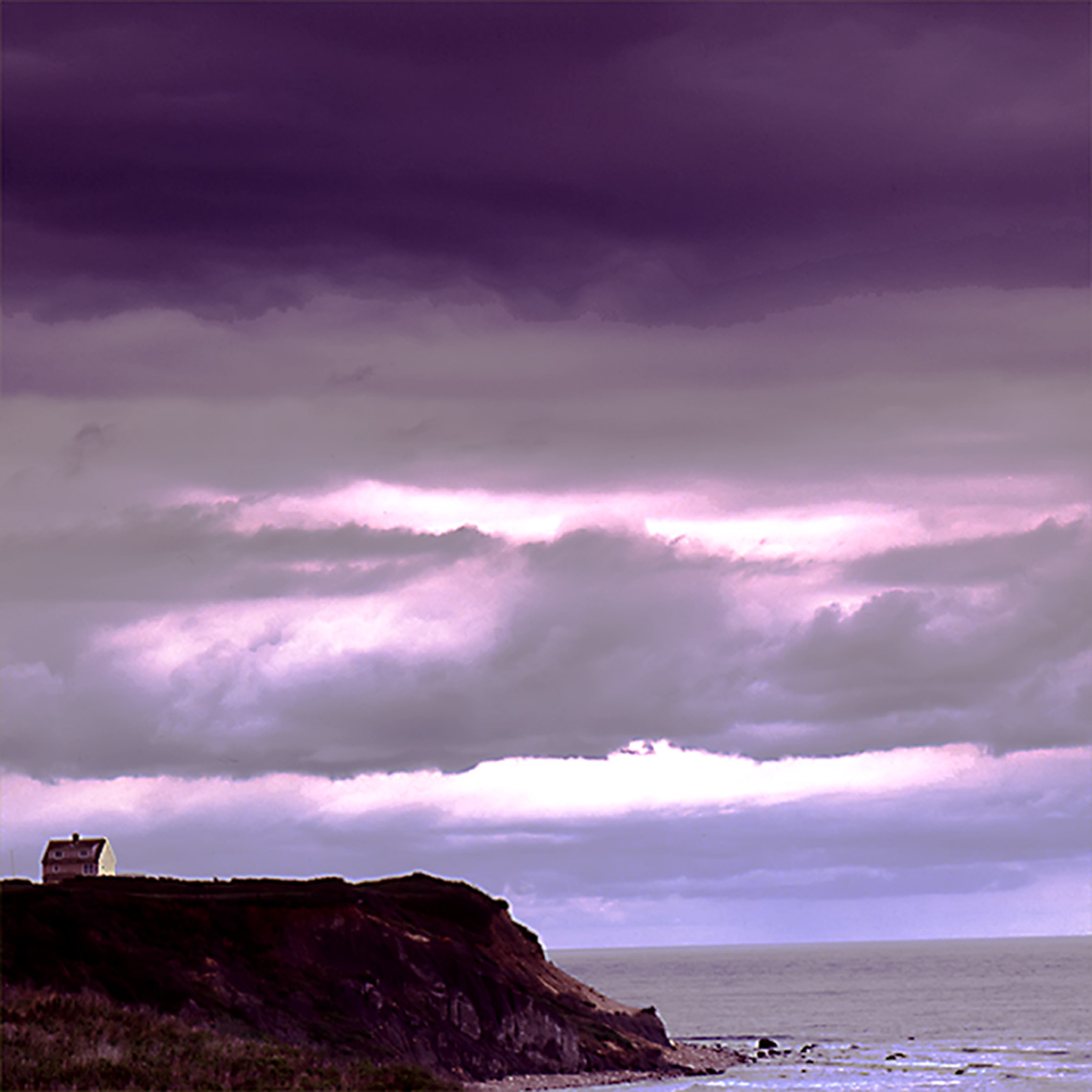 block island house on hill with storm clouds blue