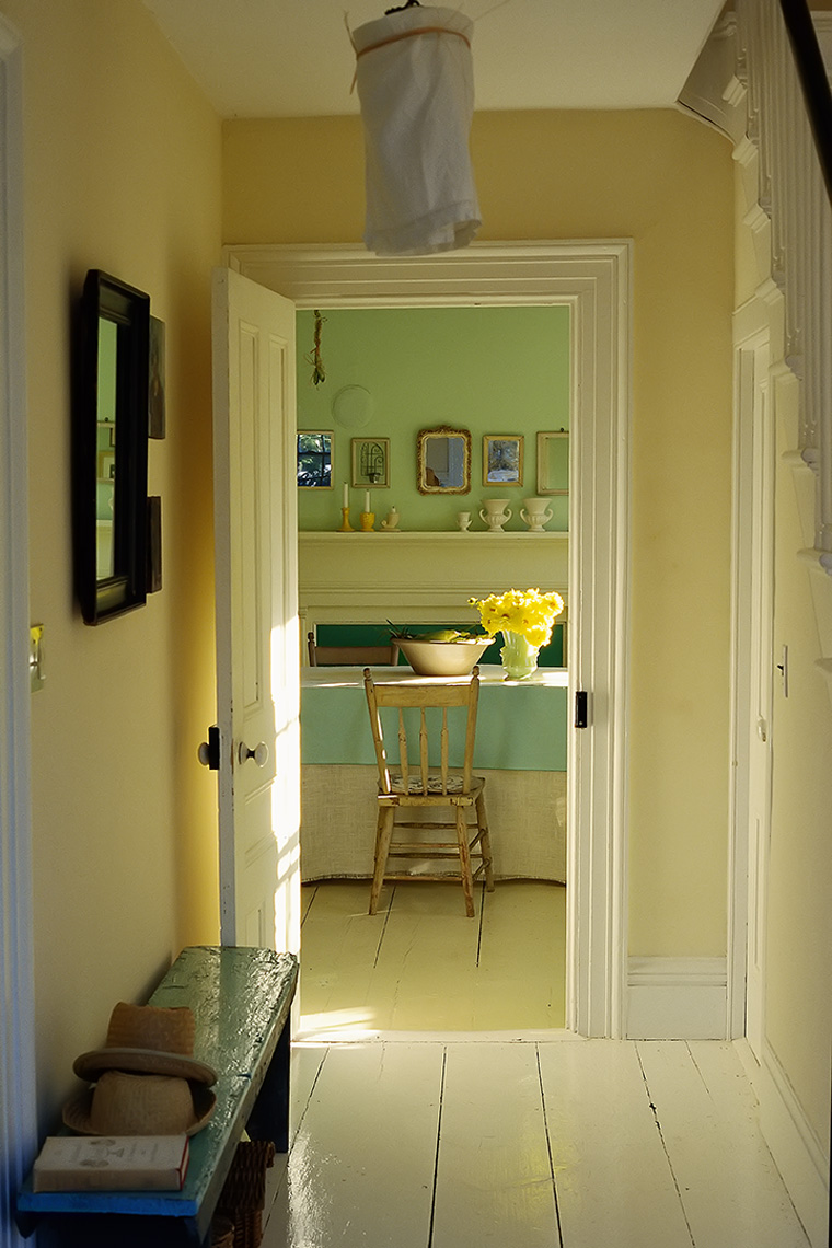 hallway with table and bowl of corn