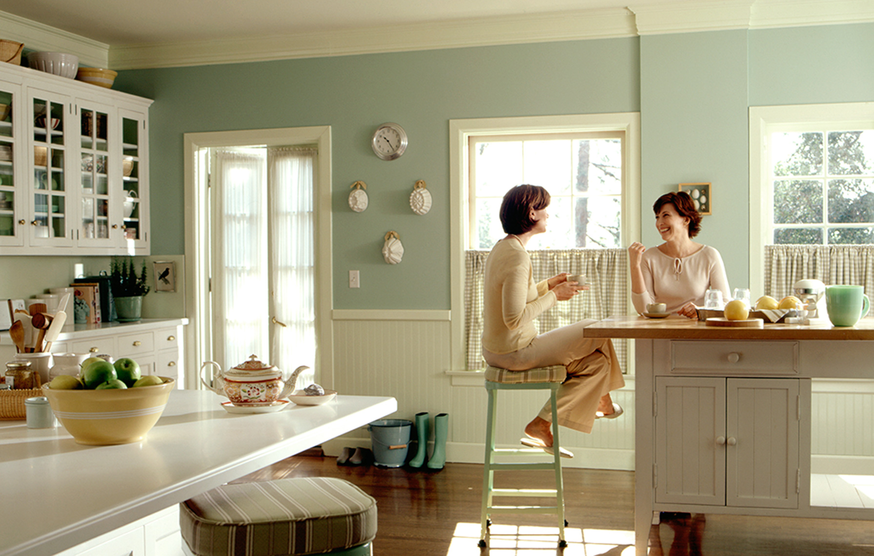 women talking in kitchen