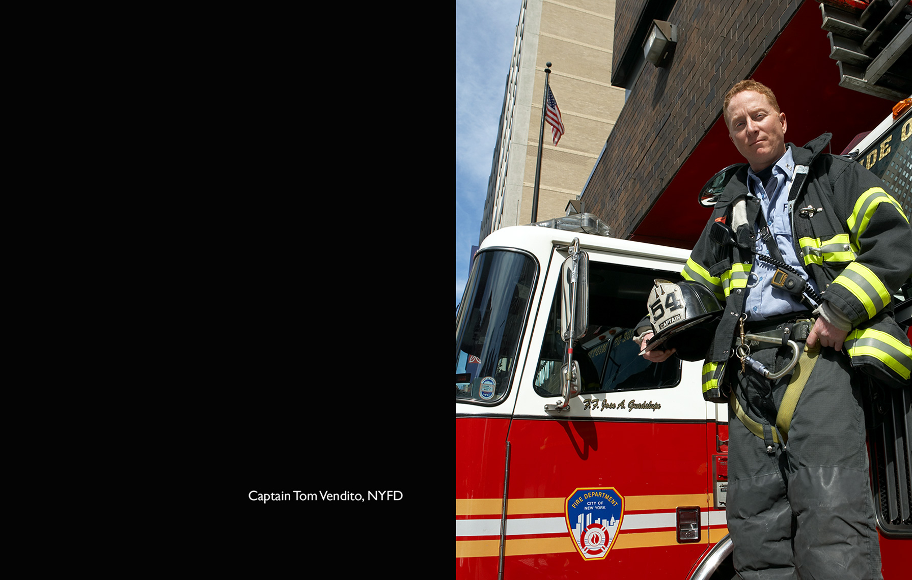 fireman standing in front of fire truck fire station