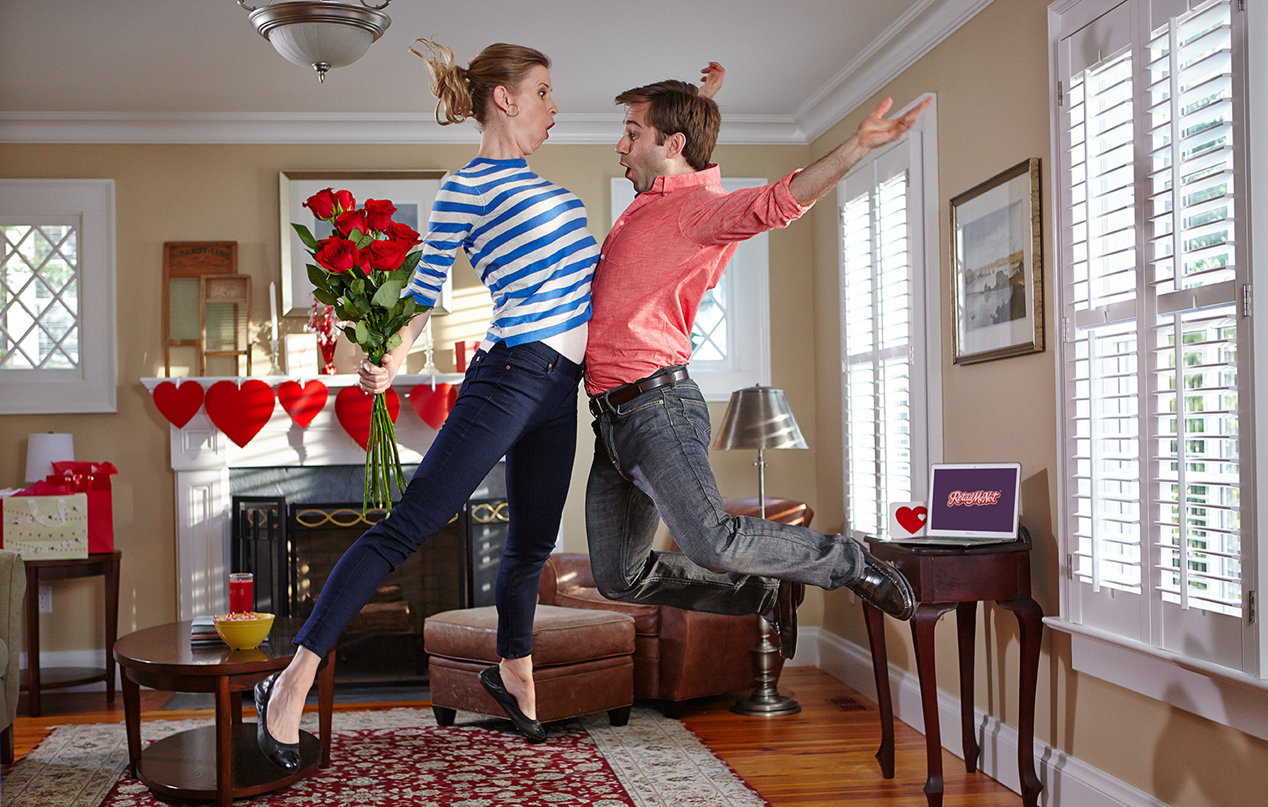 couple jumping in living room